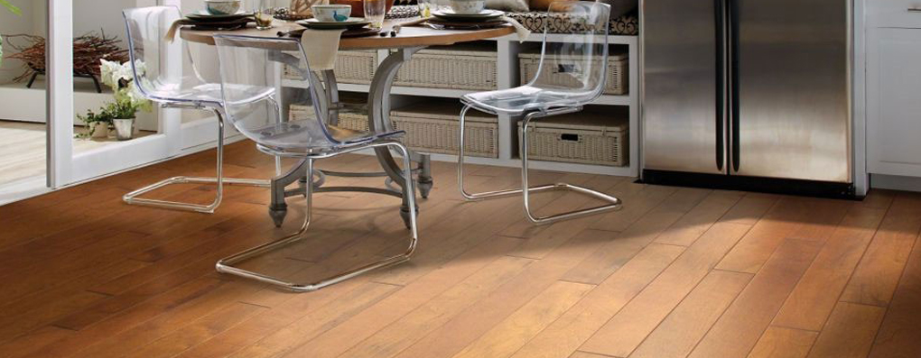 Durable laminate flooring in wood or stone visuals.
